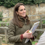 Duchess cradles her gifts including book 'The Lost Words' from TGC